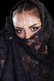 Beautiful Woman in Middle Eastern Niqab veil on isolated black b Royalty Free Stock Image