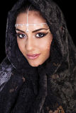 Beautiful Woman in Middle Eastern Niqab veil on isolated black b Stock Images