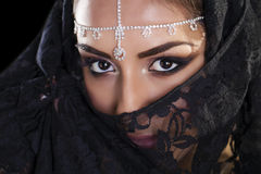 Beautiful Woman in Middle Eastern Niqab veil on isolated black b Royalty Free Stock Photo