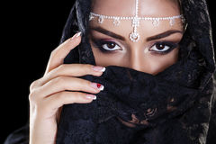 Beautiful Woman in Middle Eastern Niqab veil on isolated black b Royalty Free Stock Images