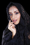 Beautiful Woman in Middle Eastern Niqab veil on isolated black b Stock Photos