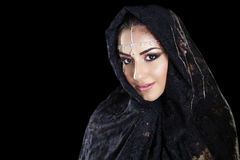 Beautiful Woman in Middle Eastern Niqab veil on isolated black b Royalty Free Stock Photography