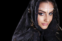 Beautiful Woman in Middle Eastern Niqab veil on isolated black b Stock Photo