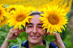 Beautiful woman in the middle of a sunflower field Royalty Free Stock Image
