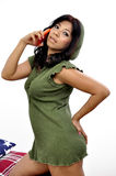 Beautiful woman mini dress uses mobile phone Royalty Free Stock Photography