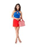 Beautiful woman in mini skirt smiling Royalty Free Stock Photos