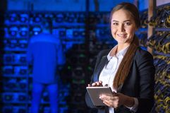 Beautiful woman at mining farm. Beautiful women at mining farm. Virtual money concept. Cryptocurrency Royalty Free Stock Photography