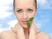 Beautiful woman with mint. Young beautiful woman with mint Royalty Free Stock Images