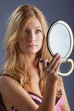 Beautiful woman with mirror Stock Image