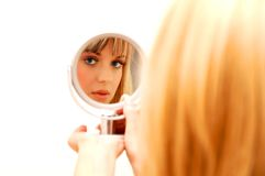 Beautiful woman in the mirror Stock Photography