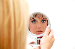 Beautiful woman in the mirror Royalty Free Stock Photos