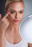 Beautiful woman with mirror Royalty Free Stock Photography