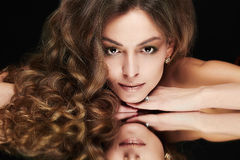 Beautiful woman with mirror reflection royalty free stock photo