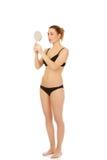 Beautiful woman mirroring. Royalty Free Stock Photos