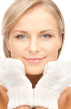 Beautiful woman in mittens Stock Image