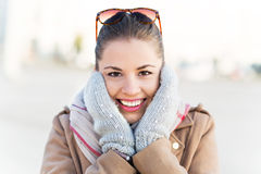 Beautiful woman in mittens Stock Photography