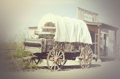 Beautiful woman mixed ethnicity. Photo of rustic wild west wagon and general store stock illustration