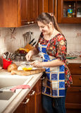 Beautiful woman mixing yolk on kitchen Royalty Free Stock Image