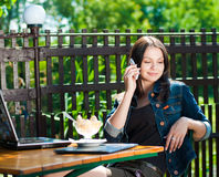 Beautiful woman on mobile phone in cafe Royalty Free Stock Photography