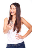 Beautiful woman with mobile phone in hand Royalty Free Stock Photo