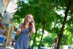 Beautiful woman with mobile phone in the street Stock Photo