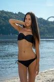 Beautiful woman model in bikini at the city beach Royalty Free Stock Photos