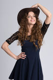 Beautiful woman model with curly hair Stock Photo