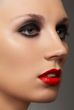 Beautiful woman model with evening fashion make-up stock image