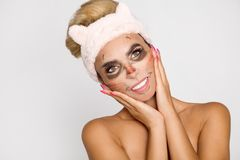 Beautiful woman with moisturizing leopard face mask. Mask with leopard, cat. stock photography