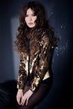 Beautiful woman model posing against grunge wall Royalty Free Stock Photos