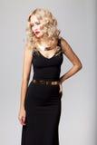Beautiful woman model posing in elegant dress. Beautiful woman model posing in elegant black dress in the studio stock images