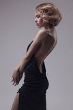 Beautiful woman model posing in elegant dress Royalty Free Stock Images