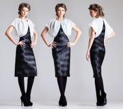 Beautiful woman model posing in elegant dress in the studio royalty free stock photography