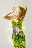 Beautiful woman model posing in elegant dress. In the studio. Double exposure overlay image of flowers stock photo