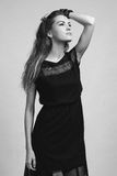 Beautiful woman model posing in elegant dress in the studio Stock Photos