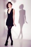 Beautiful woman model posing in elegant pearl dress in the studio Royalty Free Stock Photo