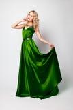 Beautiful woman model posing in green dress Stock Photos