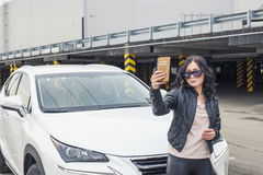 Beautiful woman model selfie in front of his car Royalty Free Stock Photography