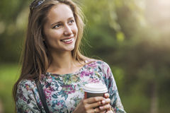Beautiful woman model with take-away coffee in the Park Stock Photography