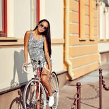 Beautiful woman model on a vintage bike outdoor Royalty Free Stock Photos