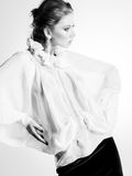 Beautiful woman model in white elegant blouse posing dramatic Royalty Free Stock Photos
