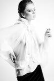 Beautiful woman model in white elegant blouse posing dramatic Stock Image