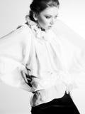 Beautiful woman model in white elegant blouse posing dramatic Royalty Free Stock Image