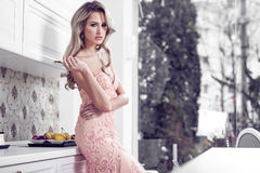 Beautiful woman in modern home royalty free stock photography