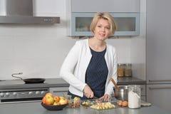 Beautiful woman in a modern kitchen Stock Photo