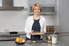 Beautiful woman in a modern kitchen Royalty Free Stock Photos