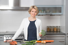Beautiful woman in a modern kitchen Stock Photos