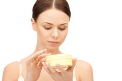 Beautiful woman with moisturizing creme Royalty Free Stock Photos