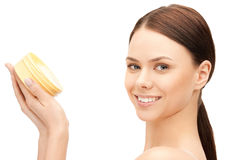 Beautiful woman with moisturizing creme Royalty Free Stock Photography
