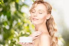 Beautiful woman with moisturizing creme Royalty Free Stock Photo